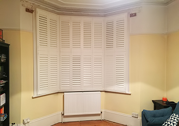 window shutters bay window